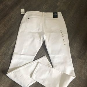 White distressed skinny jeans.